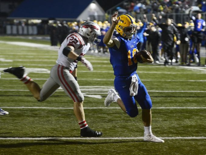 Clyde quarterback Lucas Nicely runs for a touchdown in Week 3 against Bellevue.