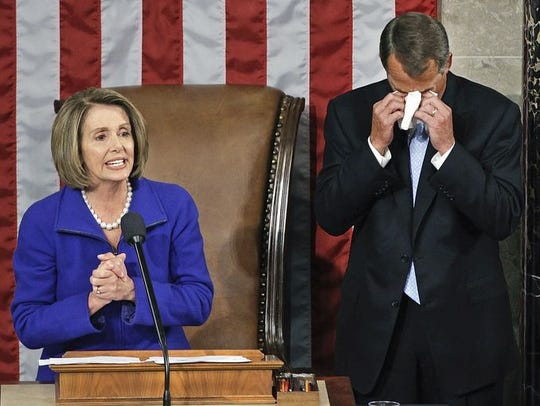 Boehner wipes away tears as he waits to receive the