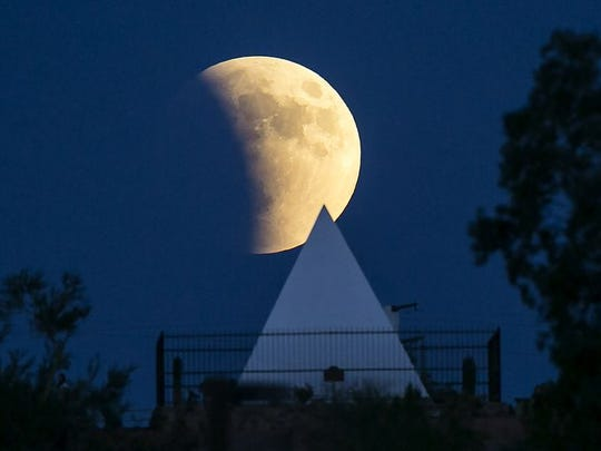 Gov. George W.P. Hunt's tomb in Papago Park with the blood moon behind it.