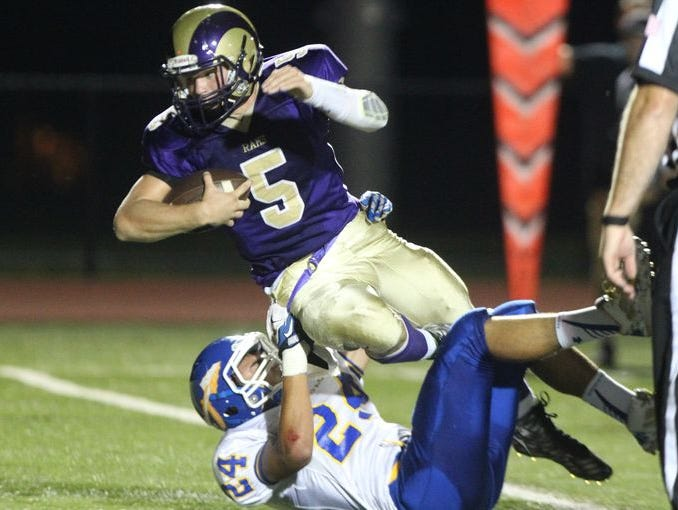 Mahopac's Robert Hoyt tackles Clarkstown North's Jack Abrams during their game at Clarkstown North Sept. 18, 2015.