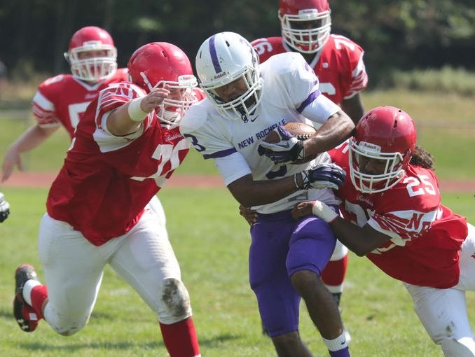 New Rochelle's Jayson Prince is hounded by North Rockland's Michael Zecchin and Michael Cintron during action in their game at North Rockland High School, Sept. 19, 2015.