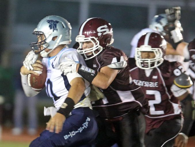 Scarsdale battled ]ohn Jay East Fishkill in a varsity football game at Scarsdale High School Sept. 25, 2015. John Jay defeated Scarsdale 36-14.