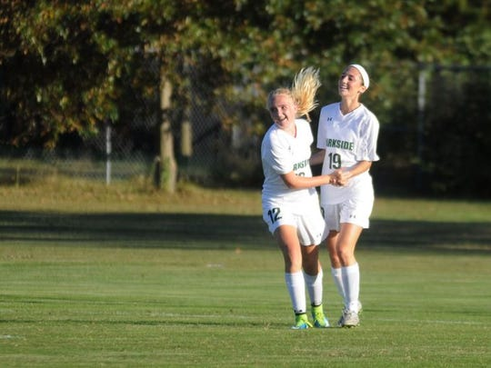 Parkside's Mackenzie Rush, left, and Blair Vilov celebrate the Rams' second goal against Stephen Decatur on Monday in Salisbury.