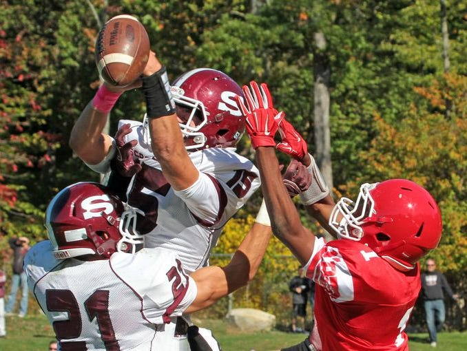Scarsdale's Michael Rolfe breaks up a pass in the end zone intended for North Rockland's Lamar Seward during a varsity football game at North Rockland High School Oct. 10, 2015. Scarsdale defeated North Rockland 28-0.