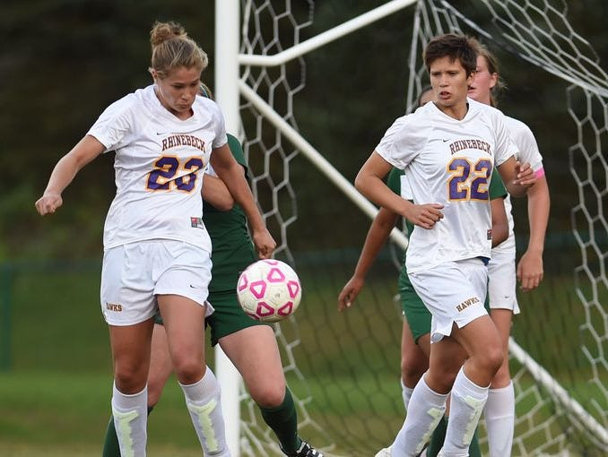 Rhinebeck High School's Marissa Gimaportone, left, and Michelle Giamportone, right, take on Spackenkill on Wednesday.