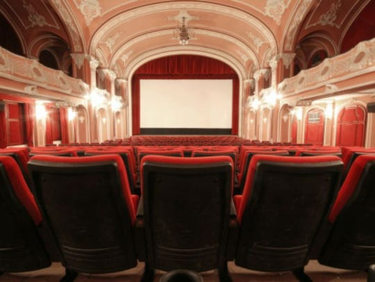 A theater screen and seats.