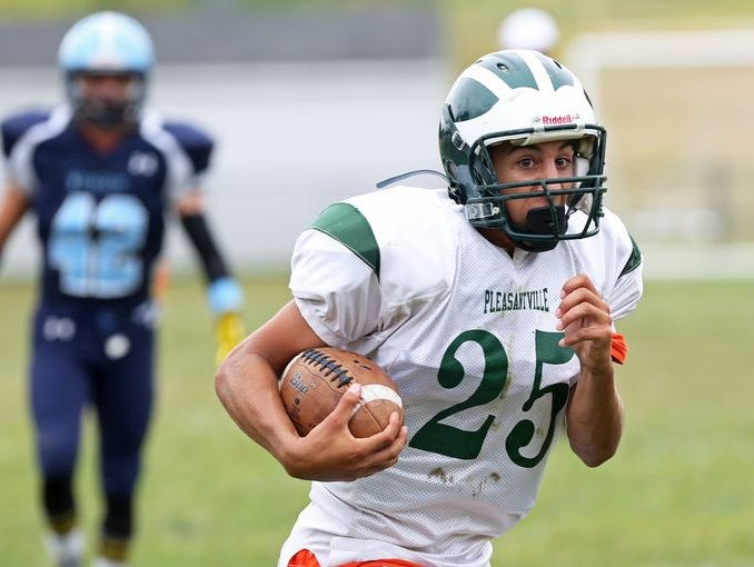 Pleasantville's Logan Schneeweiss (25) runs for a first half touchdown after catching a pass against Westlake during football action at Westlake High School in Thornwood Sept. 12, 2015. Pleasantville won the game 20-6.
