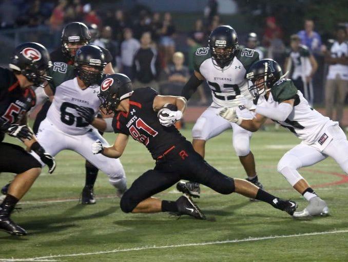 Rye's Brett Egan gains some yards during action in the Rye vs. Yorktown football game, Sept. 18, 2015 at Rye High School.