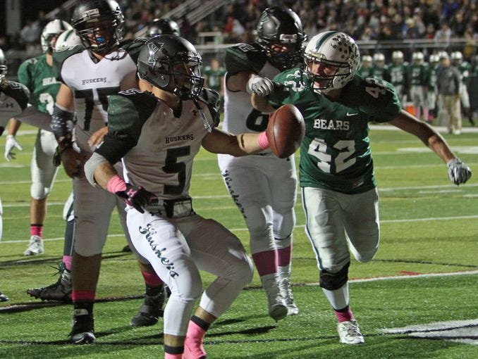Yorktown's Nick Santavicca scores during his team's 35-7 victory at Brewster High School in the Class A quarterfinals on Oct. 23, 2015.