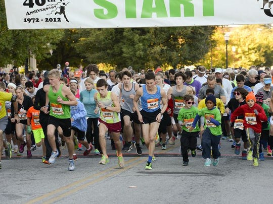 Runners participate in the 2014 Spinx Run Fest Marathon, Half Marathon, 10K & 5K held in downtown Greenville.The race is Saturday, Oct. 31.