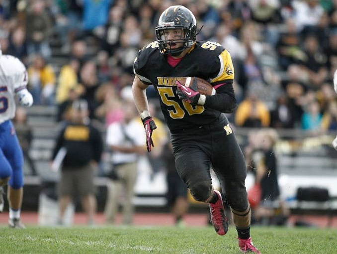 Nanuet guard Matthew Levine (52) carries the ball after an interception during their 28-0 win over Pearl River in a varsity football game at Nanuet High School in Nanuet on Saturday, Oct. 18, 2014.