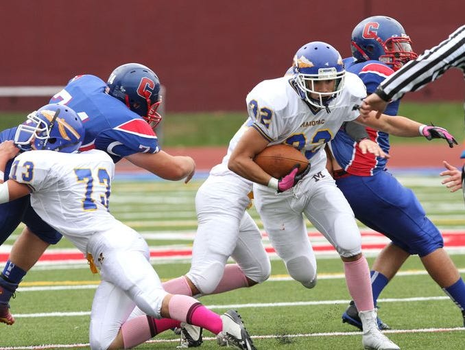 Mahopac's Joe Cavaciuti (32) looks for some running room in the Carmel defense during a boys football game at Carmel High School Oct. 11, 2014. Mahopac won the game 27-7.