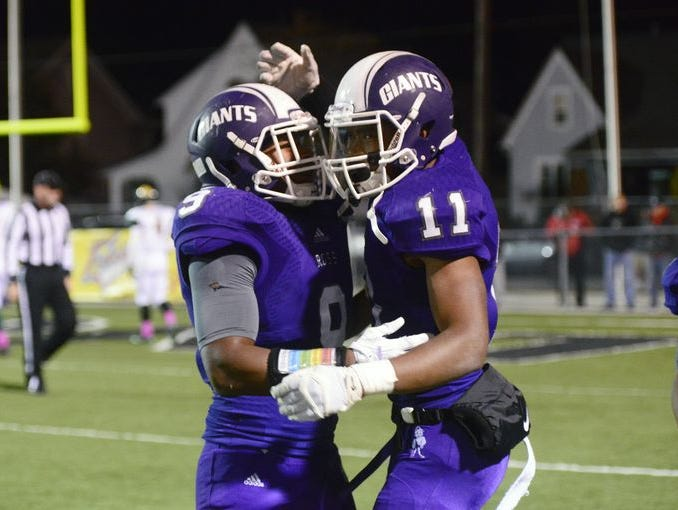Fremont Ross seniors Uriah Haun (9) and Jarren Hampton (11) celebrate a touchdown against Clay in a Week 8 victory.