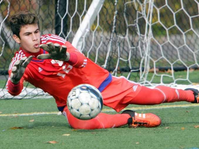 Yorktown goalie Giulino Santucci makes a save against Scarsdale during their Class AA boys soccer semifinal at Purchase College Oct. 29, 2105.