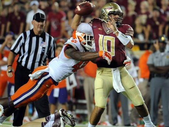 Florida State quarterback Sean Maguire looks to pass against Clemson last season as linebacker Stephone Anthony moves in.