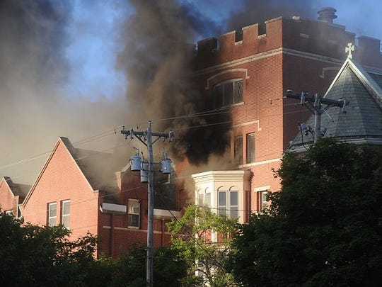 The former Sisters of the Holy Nativity Convent at 101 E. Division St. downtown caught fire June 5, 2015. Building owner George Pan-Andreas plans to restore the structure.