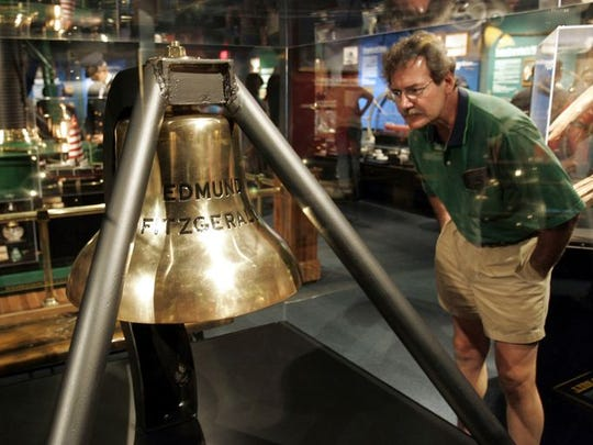 Tom Fischer of Evansville, Indiana, looks over the Edmund Fitzgerald bell on display at the Great Lakes Shipwreck Museum in Whitefish Point, Michigan, June 29, 2005.
