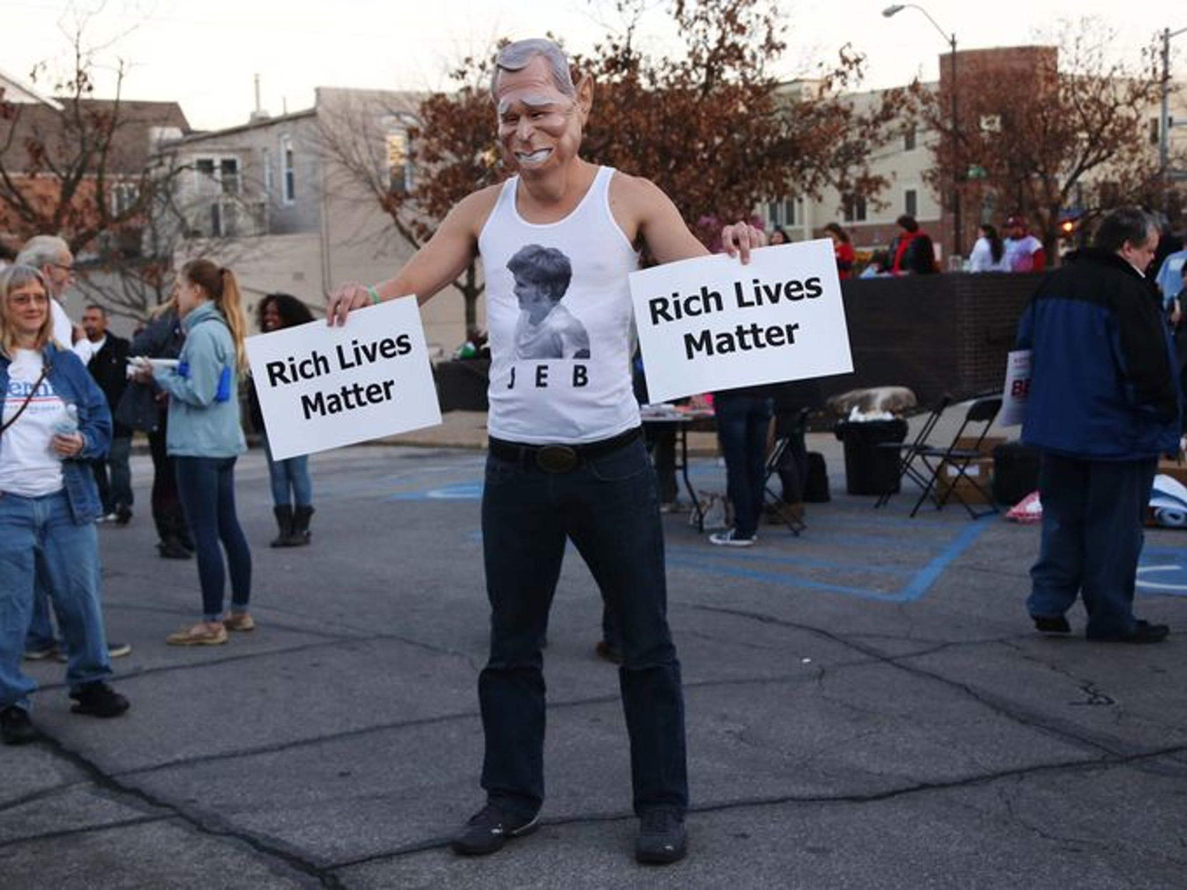 A man impersonating Jeb Bush attends a rally for Bernie Sanders near the Drake University campus before the Democratic Debate on Saturday.
