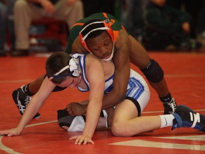 Peter Pjetri from Suffern, top, defeated Connor Breit from Nanuet in the 195-pound match at the Rockland County Championships wrestling tournament at Tappan Zee High School, Jan. 31, 2015.