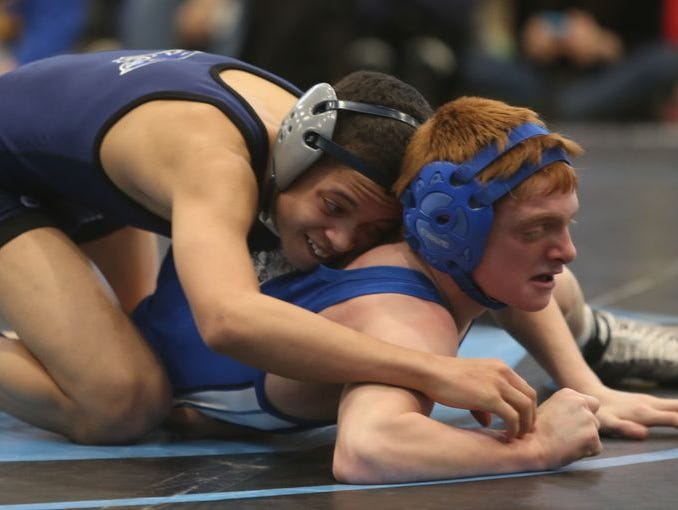 From left, Putnam Valley's Kyle Sams on his way to defeating Pearl River's Dylan Urban in the 106 pound weight class during the Division 2 sectional wrestling championship at Westlake High School in Thornwood Feb. 14, 2015.