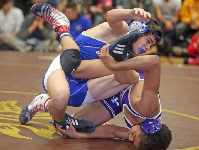 Kevin Knox of Carmel defeated Jordan Wallace of New Rochelle 6-3 to win the 126 pound title at the Division 1 sectional wrestling championships at Clarkstown South High School Feb. 15, 2015.