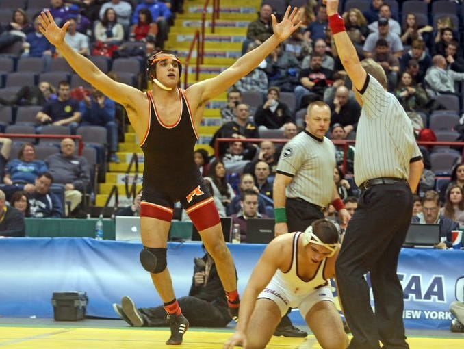 Youssif Hemida of Mamaroneck celebrates after defeating Vincent Feola of Walt Whitman in the 220 pound final at the New York State High School wrestling championships at the Times Union Center in Albany Feb. 28, 2015.