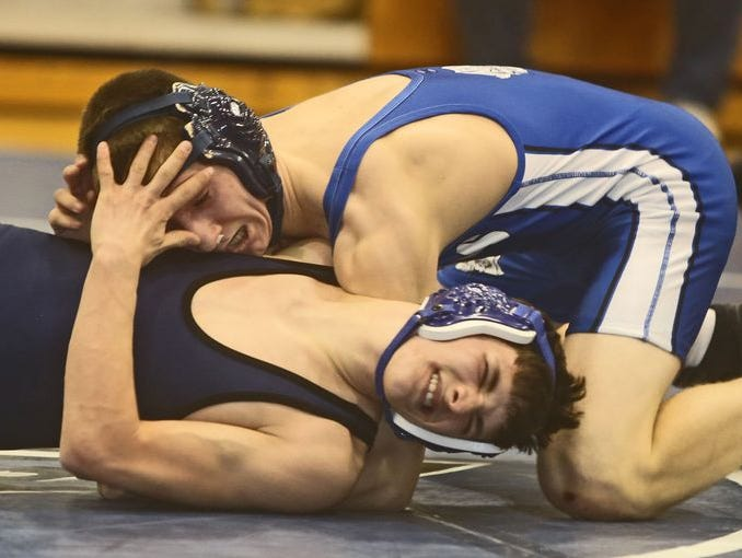 Jake Kurzhals of Pearl River pinned Alec McDonald of Putnam Valley to win a 132 pound match during the Section 1 Dual Meet Wrestling Championships Division 2 final at Putnam Valley High School Dec. 17, 2014. Putnam Valley won the match 42-39.