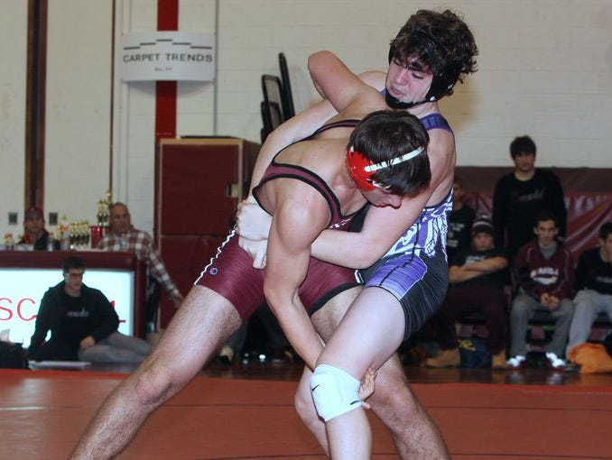 John Jay's Evan Frank, right, defeated Scarsdale's Andrew Braun in the 182-pound finals match at the Rye Dual Meet Tournament Dec. 6, 2014.