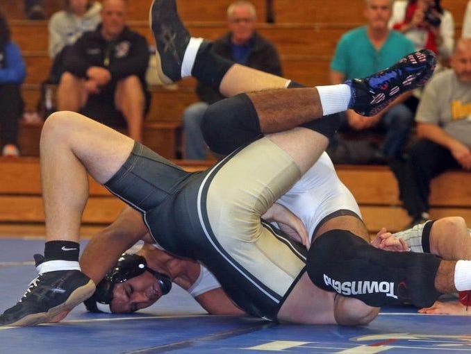 Hendrick Hudson's Sebastian Burbano, left, pinned Nanuet's Nick DiModugno in a 170 lbs. bout during a quad wrestling meet at Hendrick Hudson High School Dec. 3, 2015.