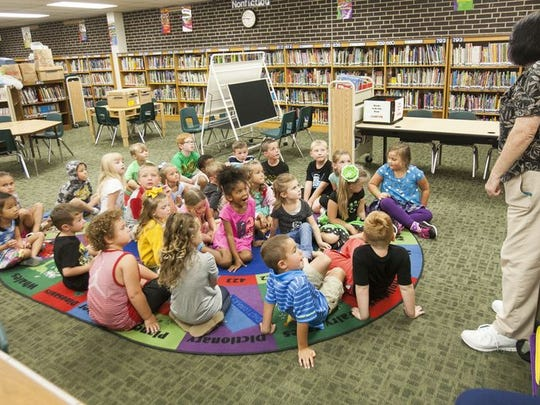 Kindergarten students circle around the library Tuesday