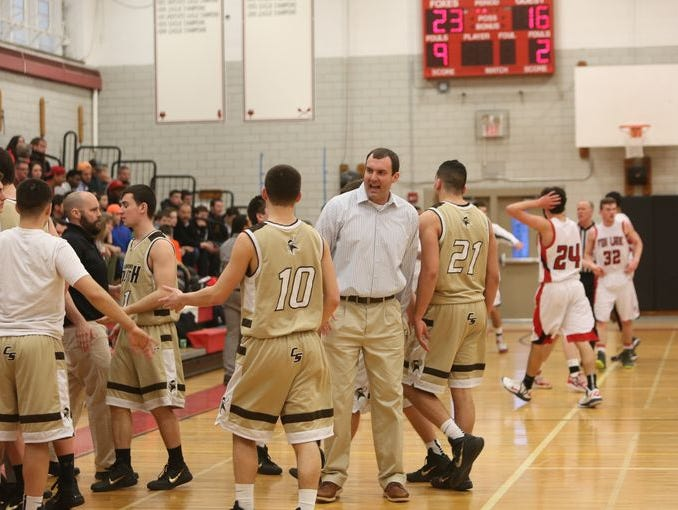 Clarkstown South coach Matt Backs (center). Backs' team has won six straight and joined this week's Top 10.