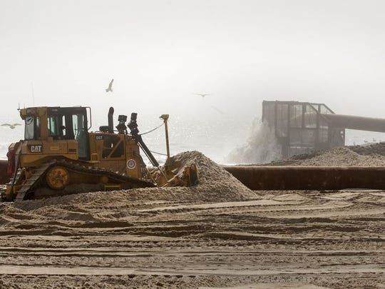 Contractors begin work on 12.7 miles of beach on Long Beach Island on May 7, 2015.