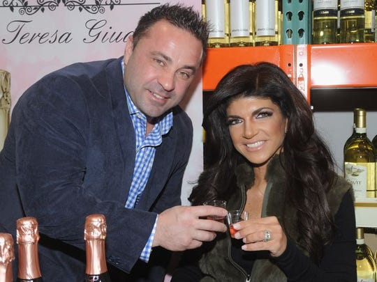 Joe Giudice and Teresa Giudice attend the Fabellini Bottle Signing and Tasting at Costco on March 1, 2014 in Plainfield, New Jersey.