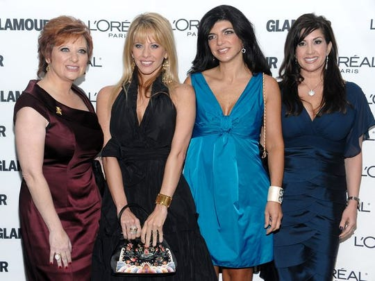 From left, Caroline Manzo, Dina Manzo, Teresa Giudice and Jacqueline Laurita of 'Real Housewives of New Jersey' attend the Glamour Magazine 2009 Women of the Year Awards at Carnegie Hall in New York.