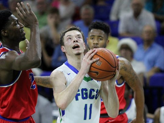 FGCU sophomore Christian Terrell looks to score during