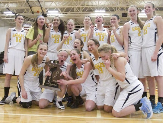 The Hartland girls basketball team won a regional title