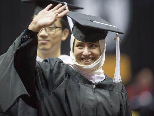 A Ball State University graduate waves during the 2015