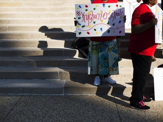 Pat Johnson held a sign during a rally on the steps of City Hall downtown.The rally was organized by the Black Alliance for Educational Options to voice support for charter schools in Kentucky.