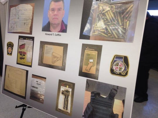 A board featuring photos of items found during the arrest of Howard Timothy Cofflin Jr. was on display during a news conference held by state police.