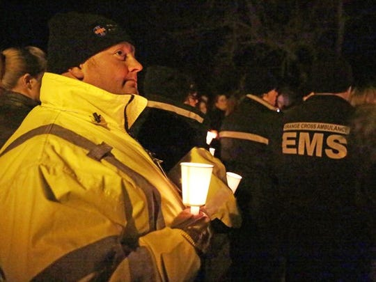 First responders attend a candlelight vigil for the