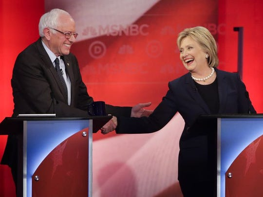 Sen. Bernie Sanders and Hillary Clinton shake hands during a Democratic presidential primary debate.