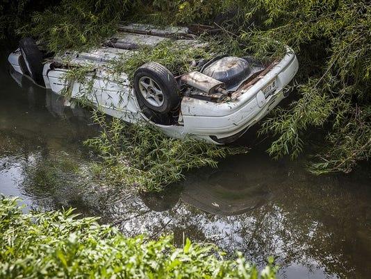 635906105382426625-car-in-creek.JPG