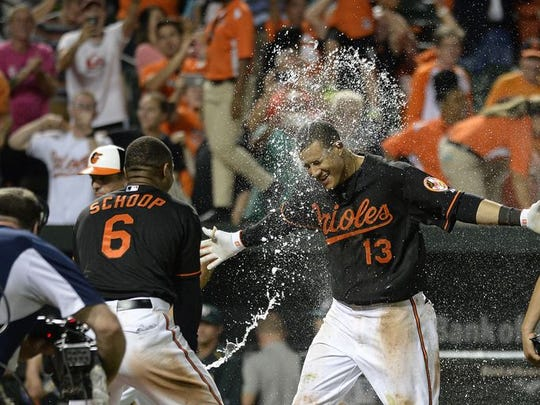 Manny Machado is welcomed with splash of water from