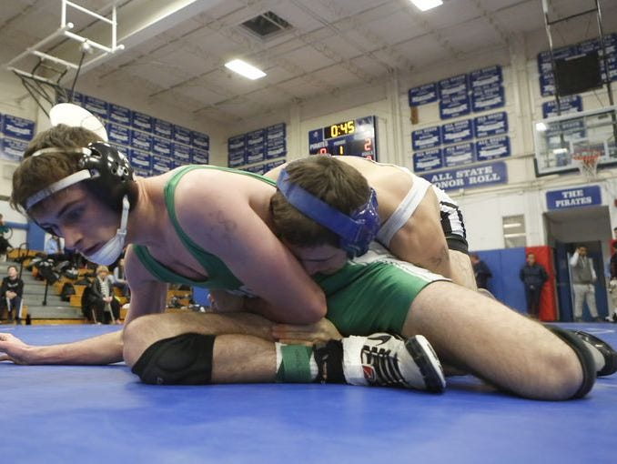Irvington's Matthew Montaruli, bottom, wrestles Hen Hud's Peter Maselli in a 138-pound match in the section 1 division 2 quarterfinals at Pearl River High School on Friday, Feb. 12, 2016.