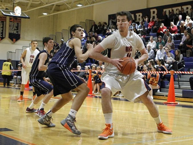 Briarcliff center Sean Crowley (11) drives the baseline during their 54-48 win over Putnam Valley at Briarcliff High School on Thursday, Jan. 7, 2016.