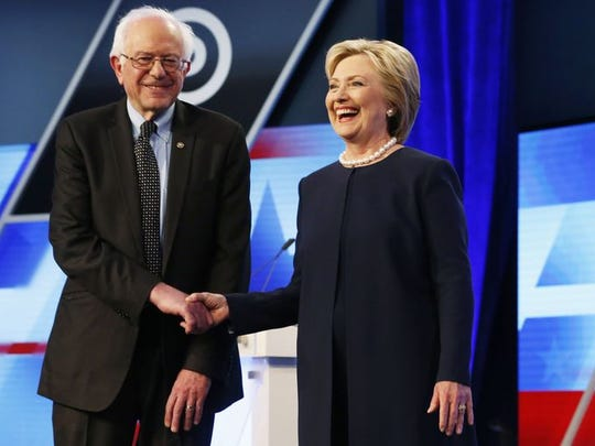 Hillary Clinton and Sen. Bernie Sanders, I-Vt, shake hands before the start of the Democratic presidential debate.