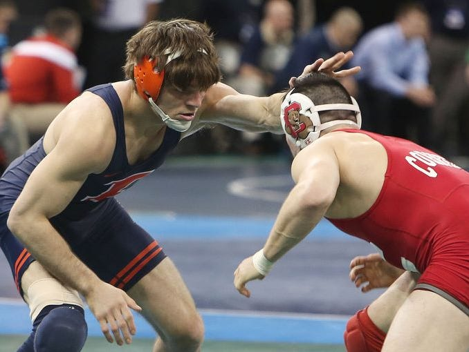 Illinois' Steven Rodrigues on his way to defeating Cornell's George Pickett in the quarterfinals of the 165-pound weight class during the NCAA Wrestling Championships at Madison Square Garden March 17, 2016. Rodrigues, a Fox Lane graduate, won the match.
