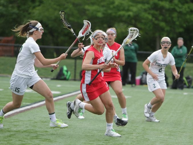 Somers' Izza LaRocca (14) is defended by Yorktown's Ashley Stilo during the Class B final at Torne Valley Stadium on May 21st, 2015. Somers won 10-9.
