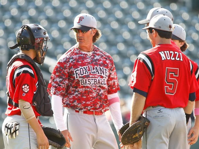 Fox Lane coach Matt Hillis comes to the mound to talk to his players in the class AA section finals baseball game against R.C. Ketcham at Provident Bank Park in Ramapo on Saturday, May 31, 2014