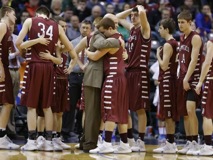 Bloomfield coach Matt Britton consoles team after loss to Liberty Christian in Class A championship on Saturday.
